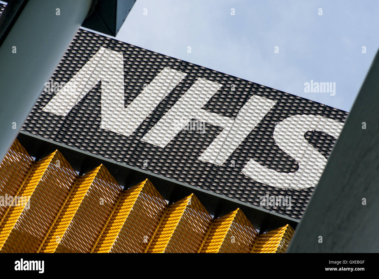 NHS Sign on a Multi Story Car Park - Stock Image