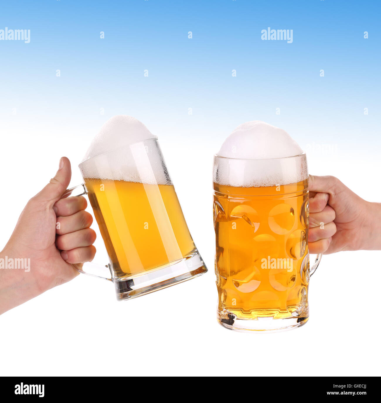 pair of very cool beer glasses on a blue sky stock photo 119560522