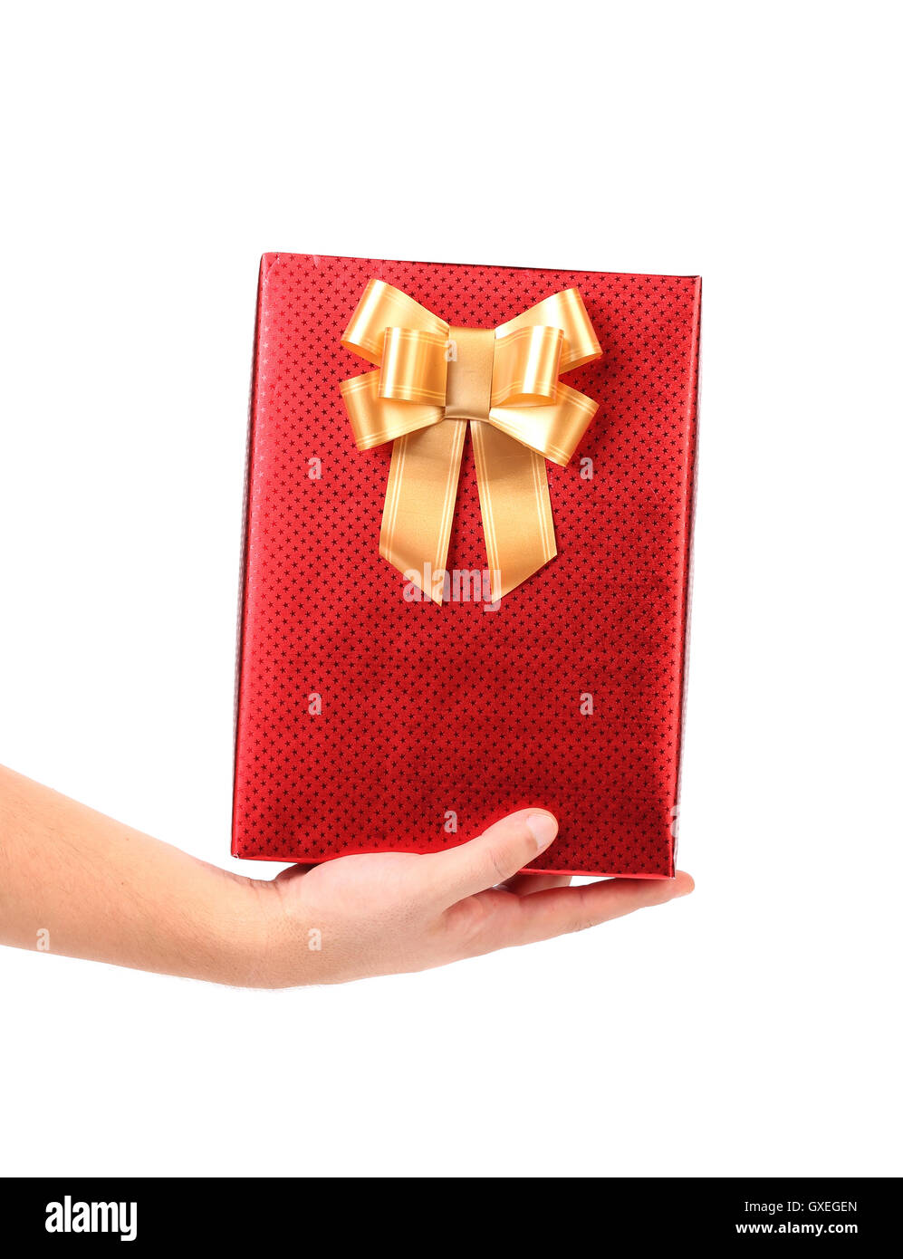 Hand holds box with bow studded asterisks. - Stock Image