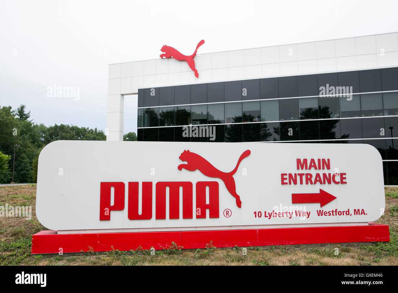 A logo sign outside of the headquarters of Puma North America, Inc., in Westford, Massachusetts on August 13, 2016. - Stock Image
