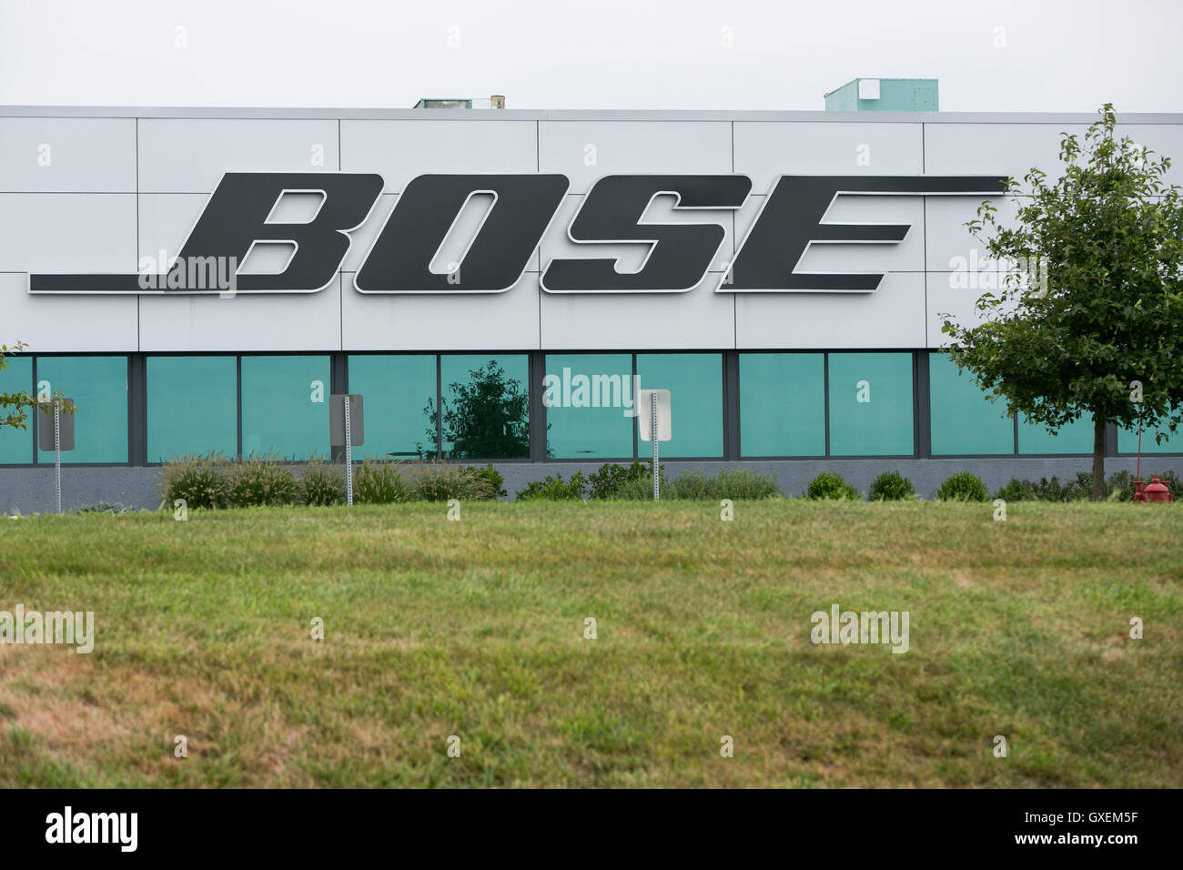A logo sign outside of the headquarters of the Bose Corporation in Framingham, Massachusetts on August 13, 2016. - Stock Image