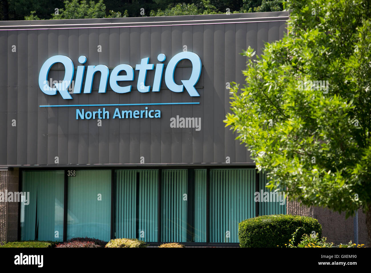 A logo sign outside of the headquarters of QinetiQ North America in Waltham, Massachusetts on August 13, 2016. - Stock Image