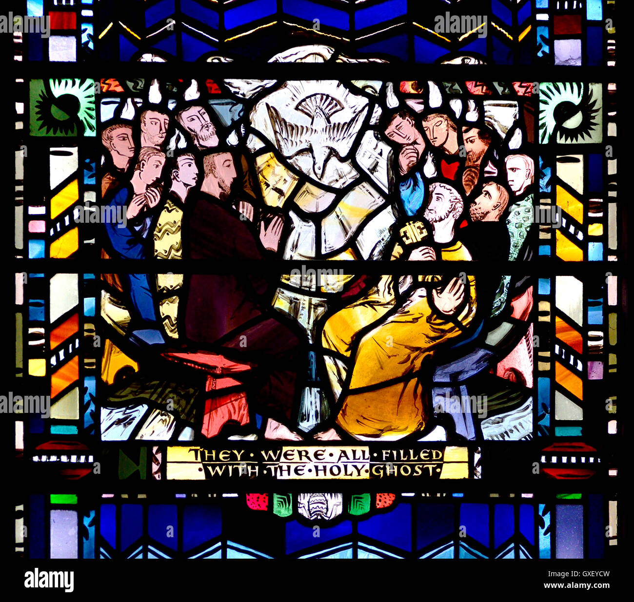 London, England, UK. St Etheldreda's Church in Ely Place. Stained glass window: Bible scene. Acts 2:4 speaking - Stock Image