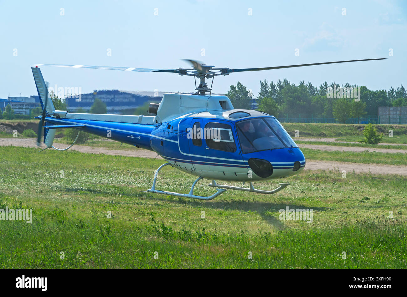 Takeoff copter after an emergency landing on the green glade in the suburbs - Stock Image