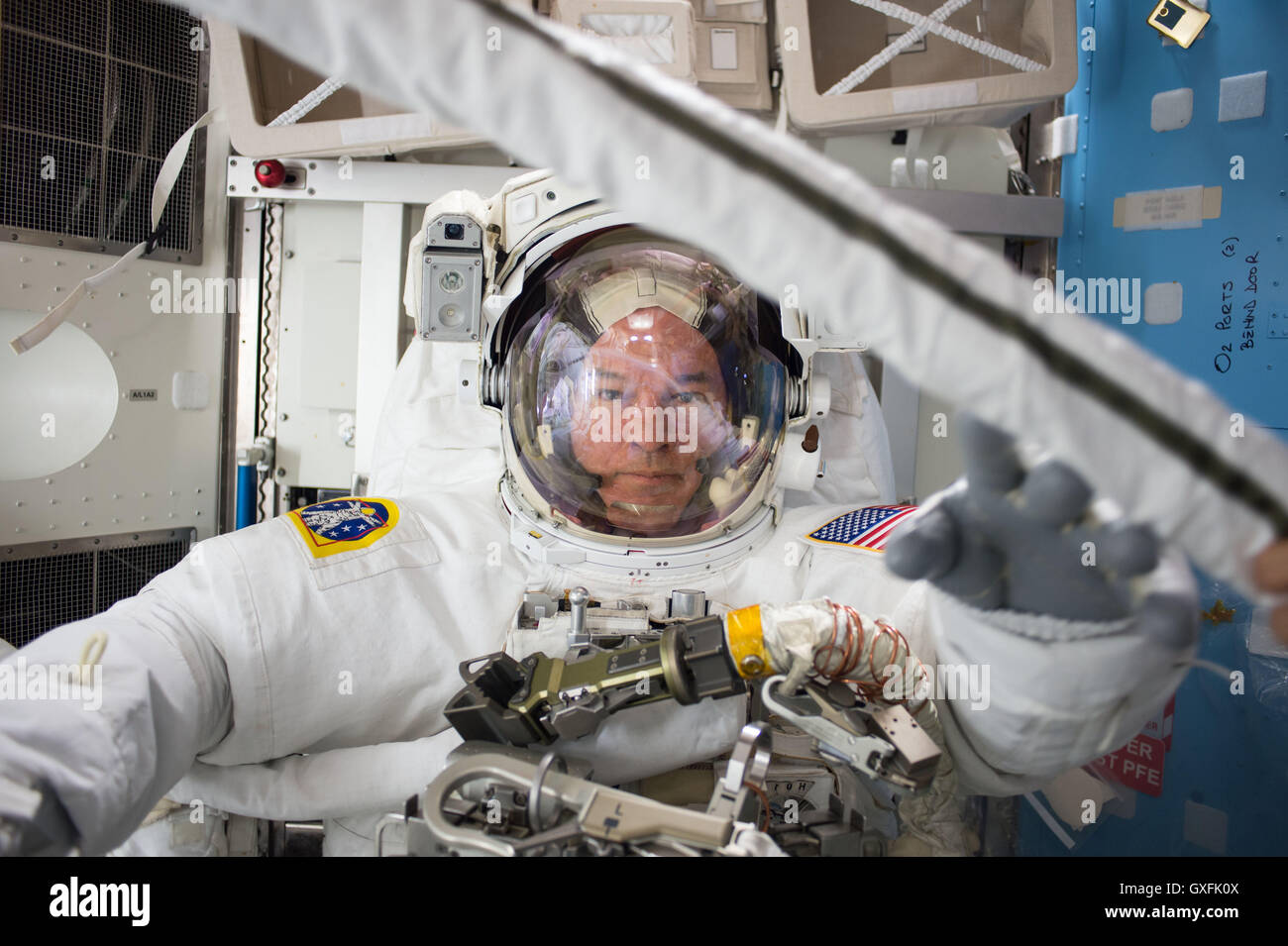 International Space Station Expedition 48 crew member NASA astronaut Commander Jeff Williams following a spacewalk - Stock Image