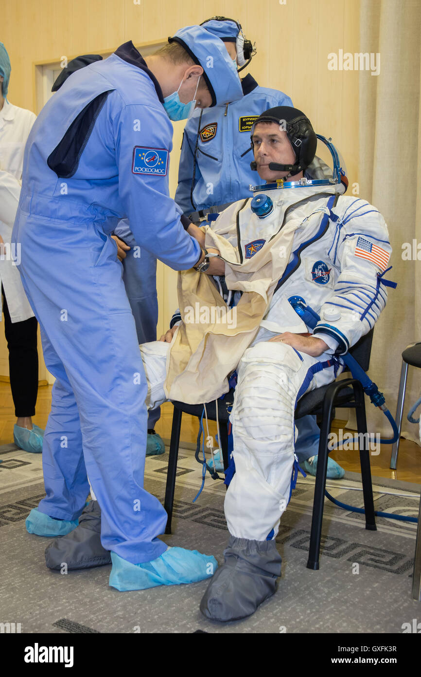 International Space Station Expedition 49 crew member astronaut Shane Kimbrough suits up during a pre-launch training - Stock Image