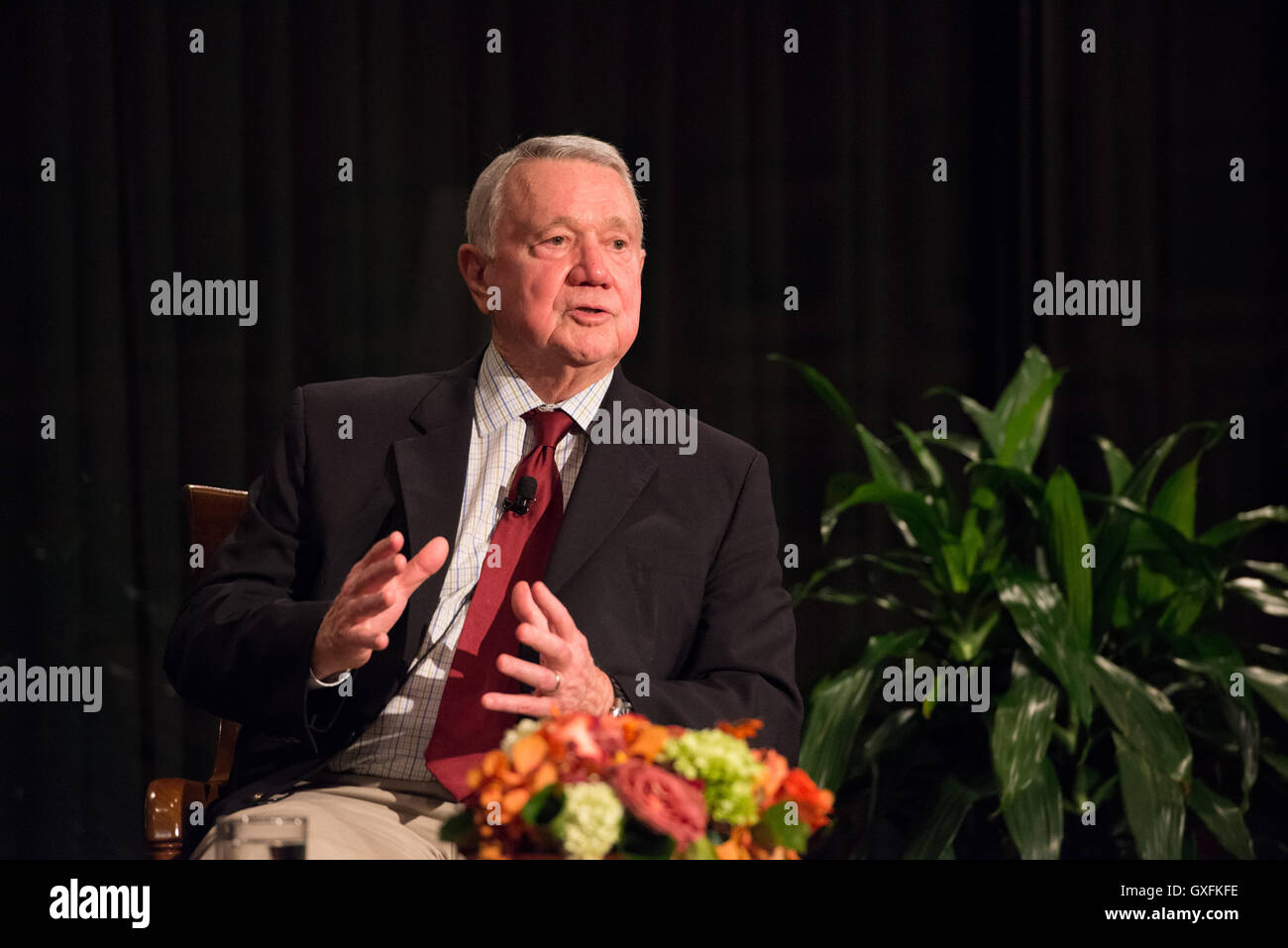 Austin Mayor Lee Leffingwell speaks about the new city counsel electoral process during a discussion at the LBJ - Stock Image