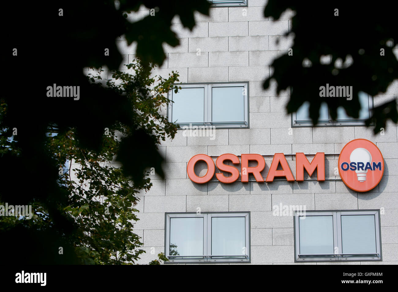A logo sign outside of facility occupied by Osram in Milan, Italy on September 3, 2016. Stock Photo