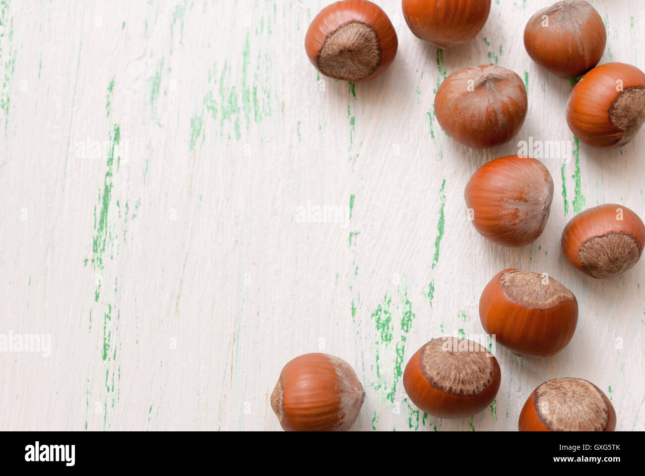Nuts in the shell on a wooden Board closeup - Stock Image