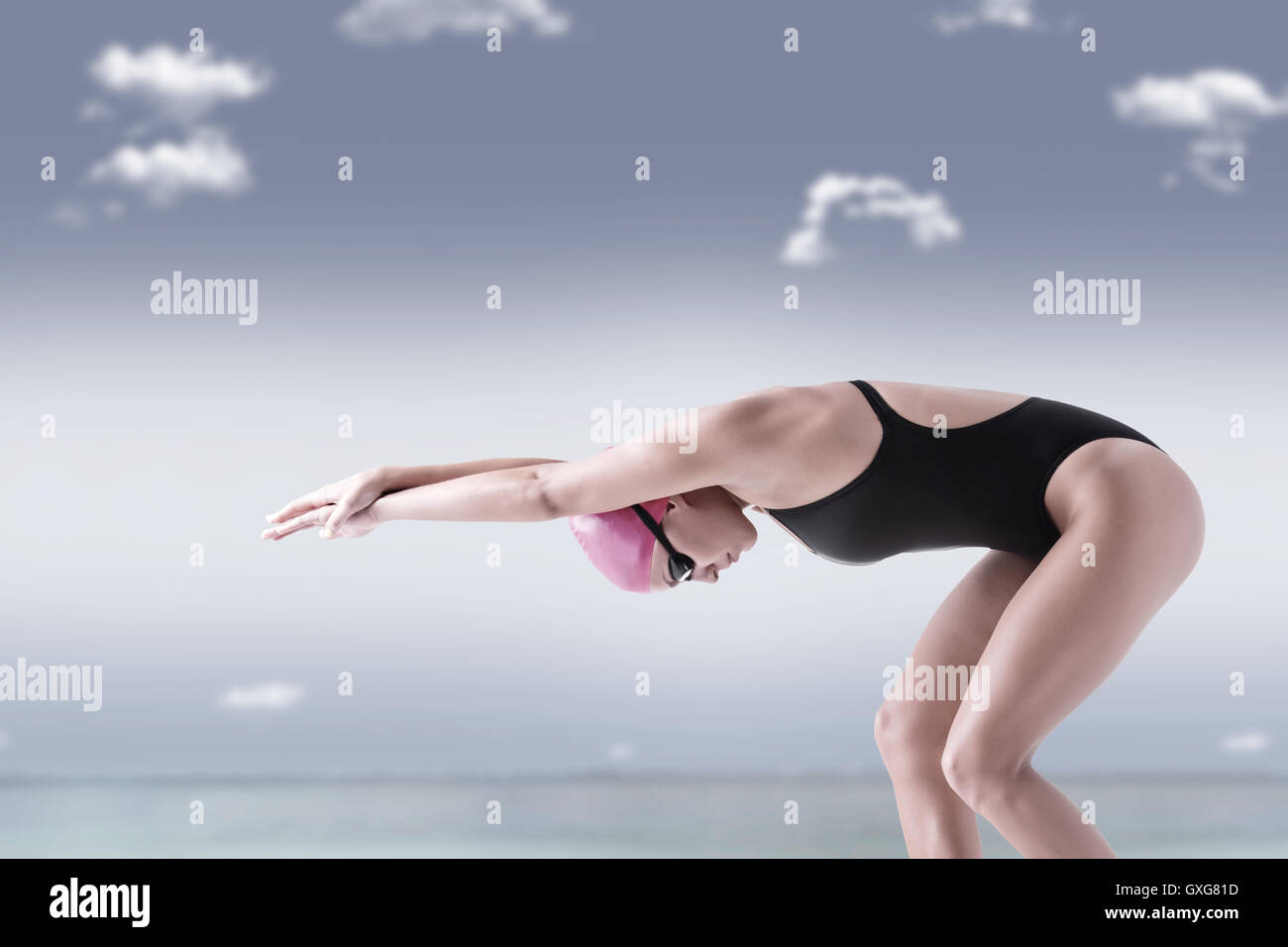 Female swimmer ready to jump to the water. Conceptual image. - Stock Image