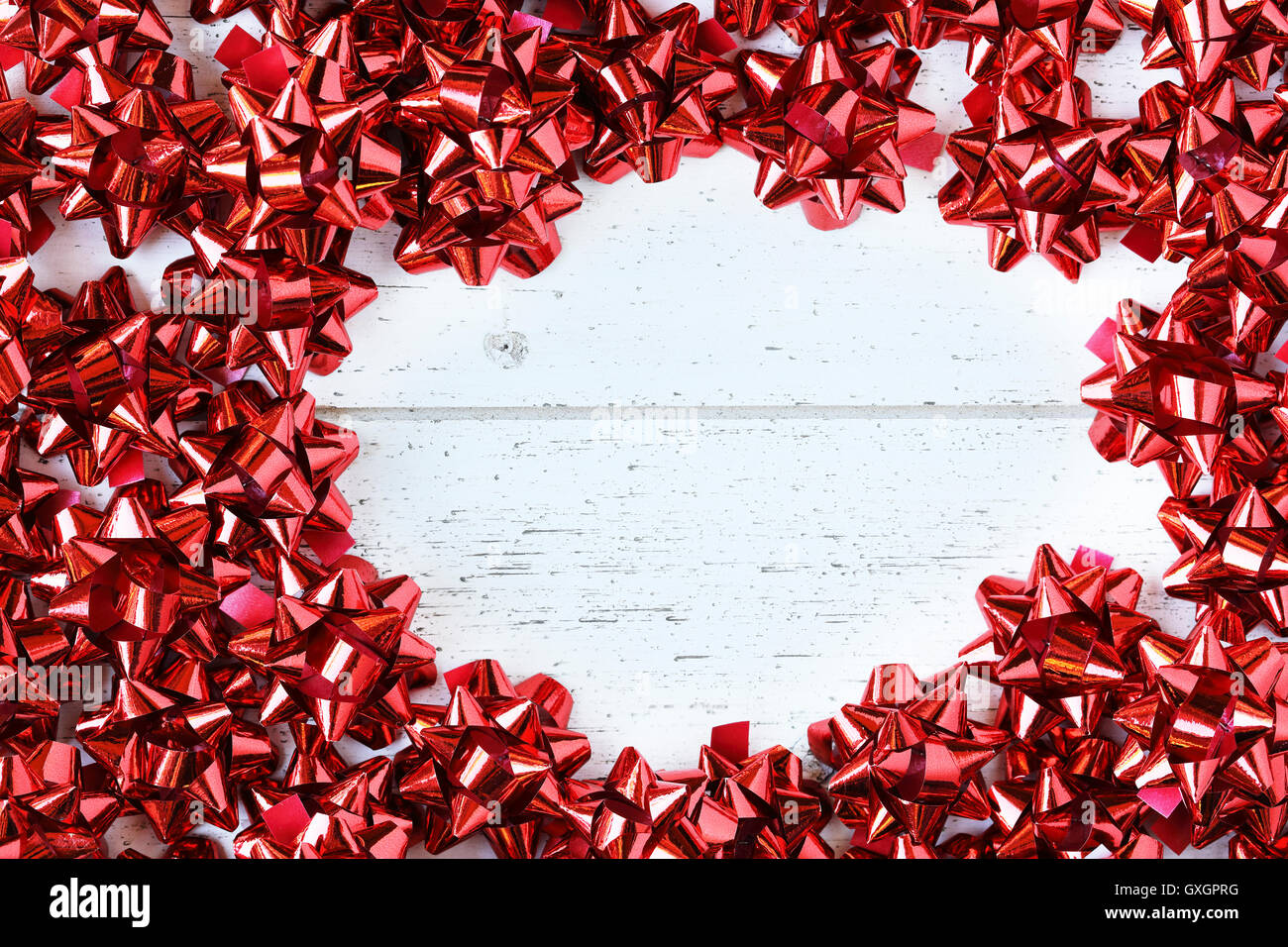 Many red decorative bows for Christmas or other gifts, with copy space. - Stock Image