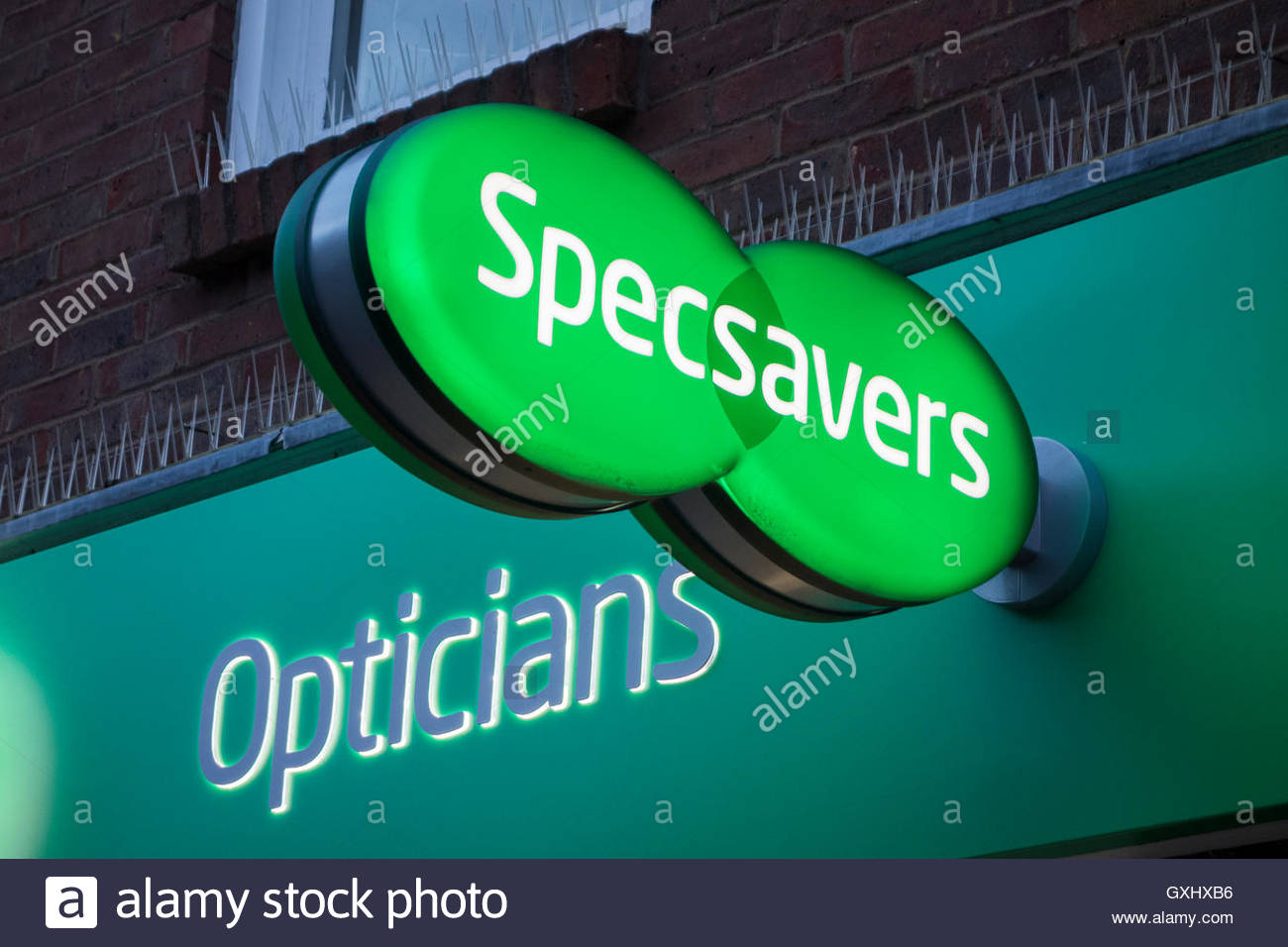 Signs on a Specsavers opticians retail store in Huntingdon High Street Stock Photo