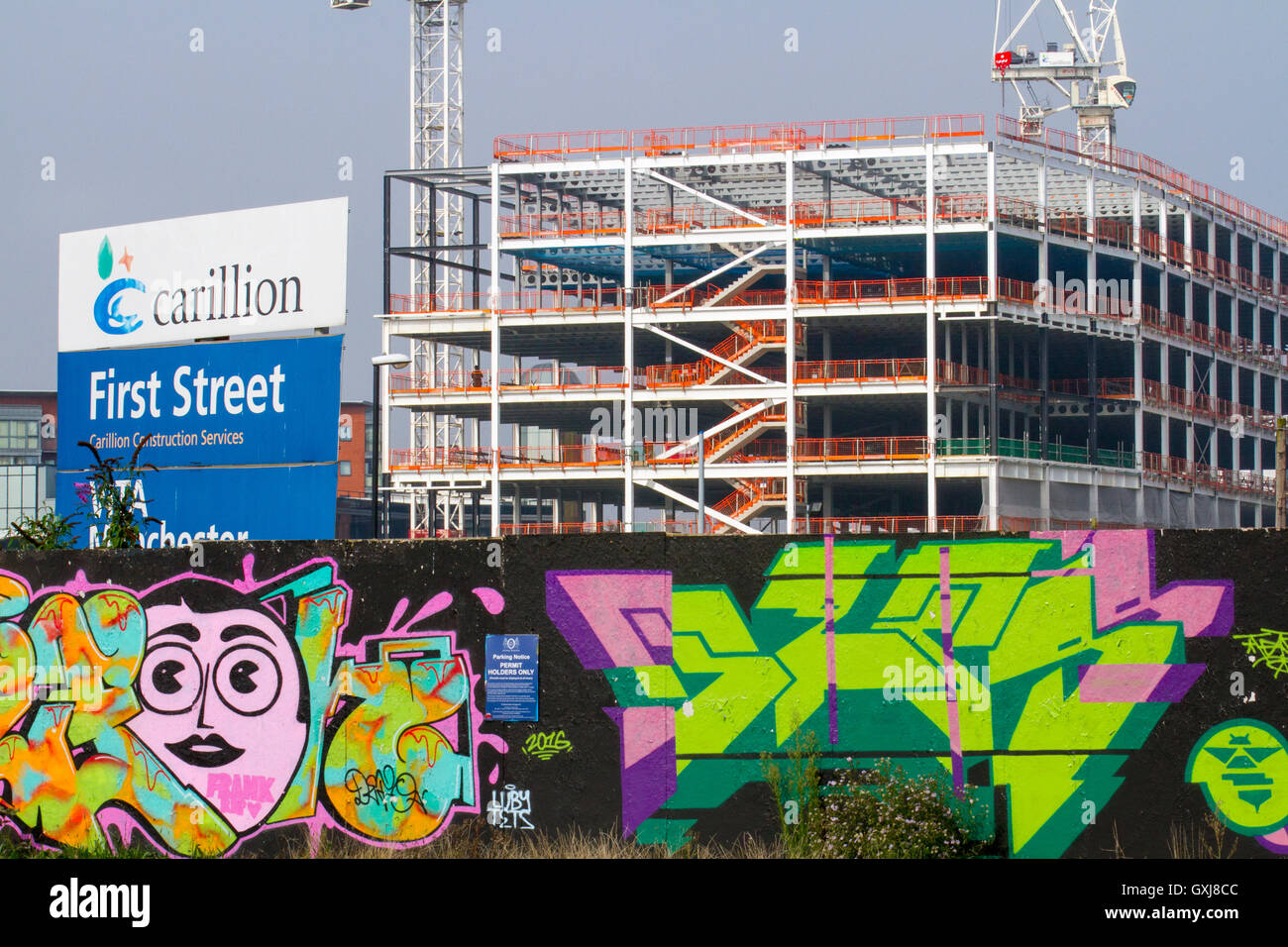 First Street Carillon developments, hoardings, muraks and high-rise buildings in the Castlefield area of 1st Street Stock Photo