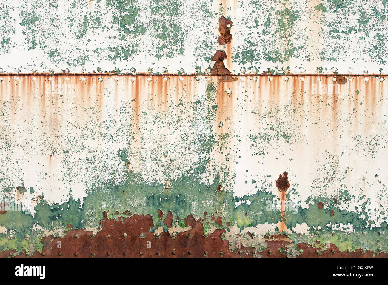 Peeling paint rust and rivets texture. Old metal garage door & Peeling paint rust and rivets texture. Old metal garage door Stock ...