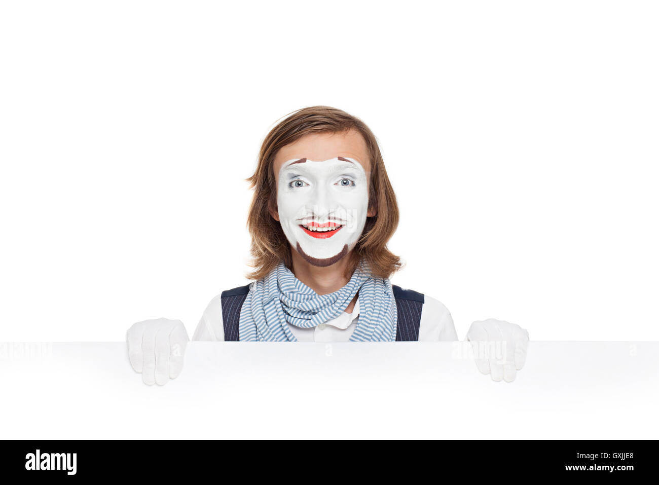 mime smiling with white billboard - Stock Image