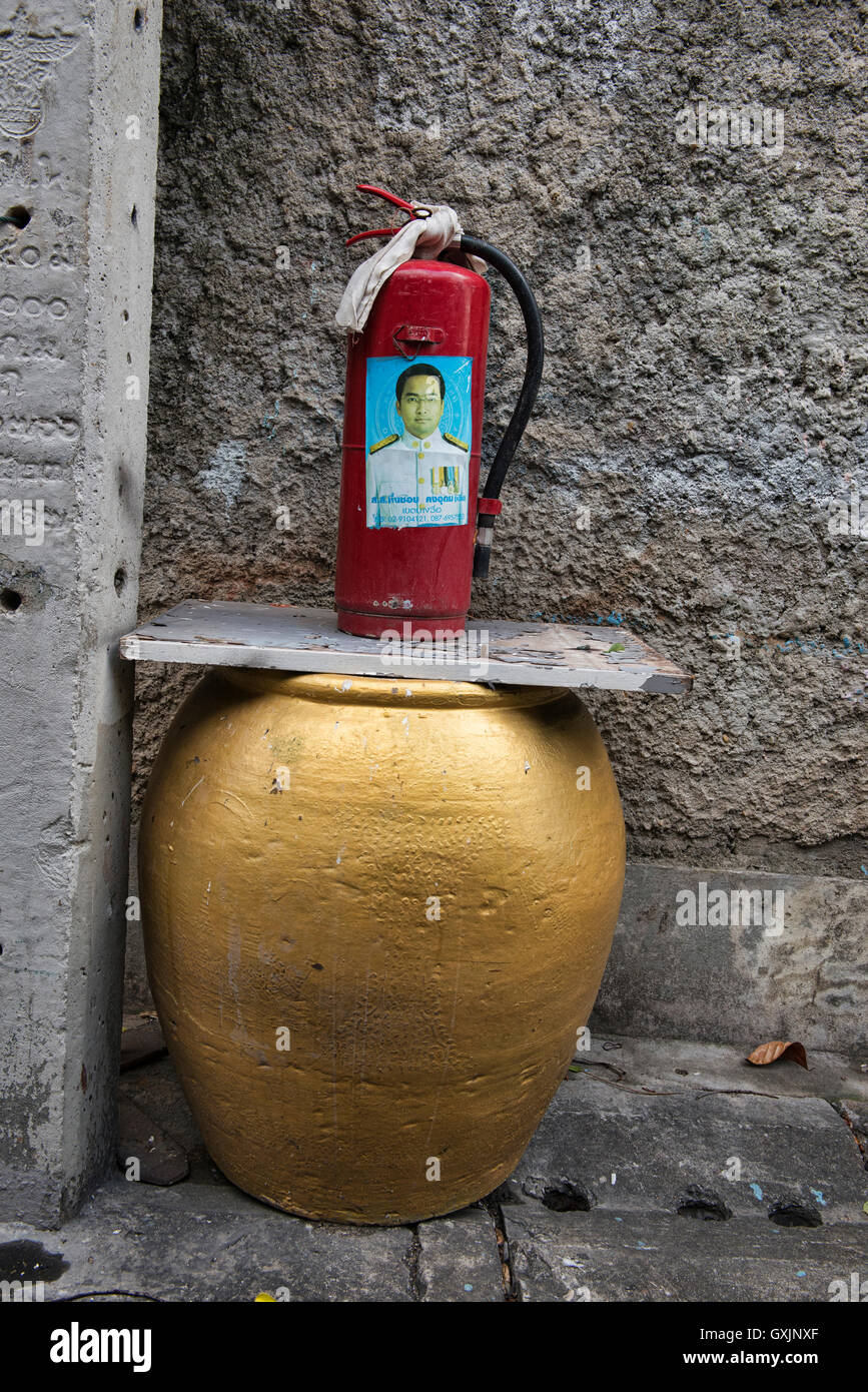 Old and new style fire safety, Bangkok, Thailand - Stock Image