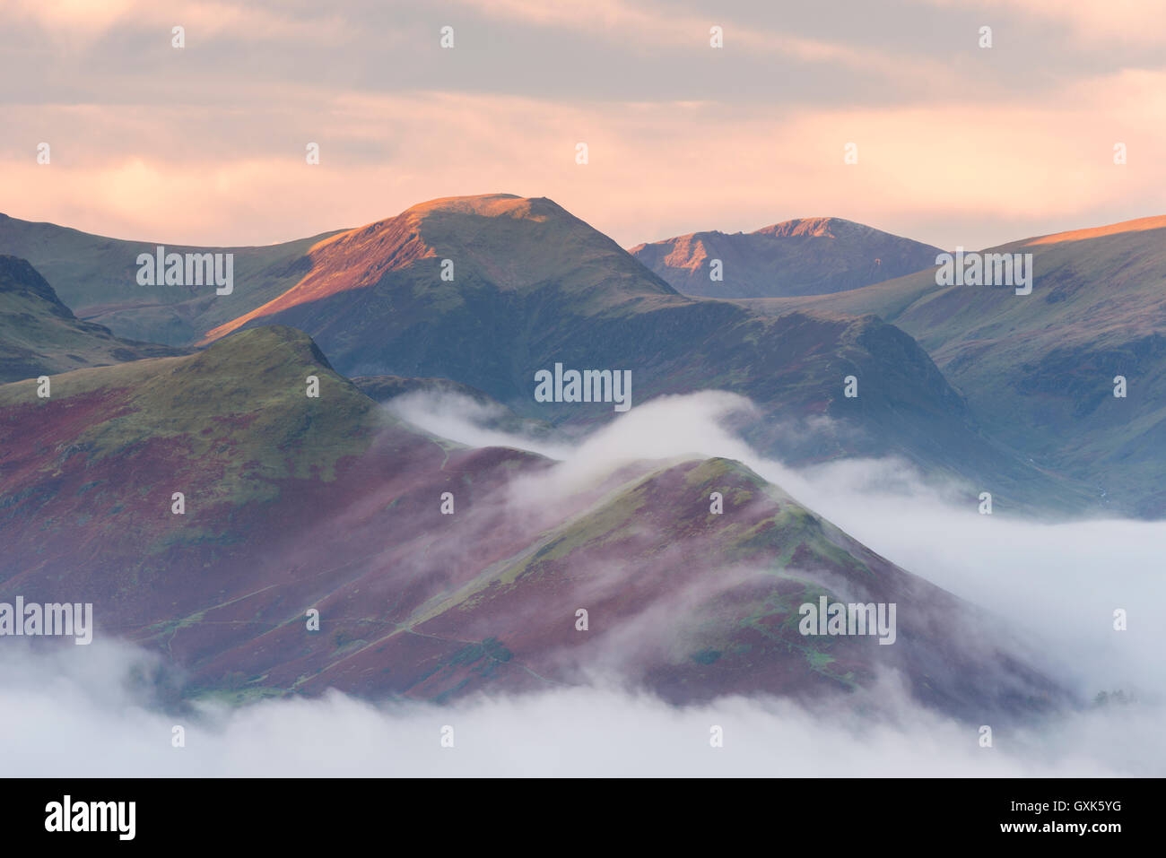 Catbells mountain surrounded by morning mist, Lake District National Park, Cumbria, England. Autumn (November) 2014. - Stock Image