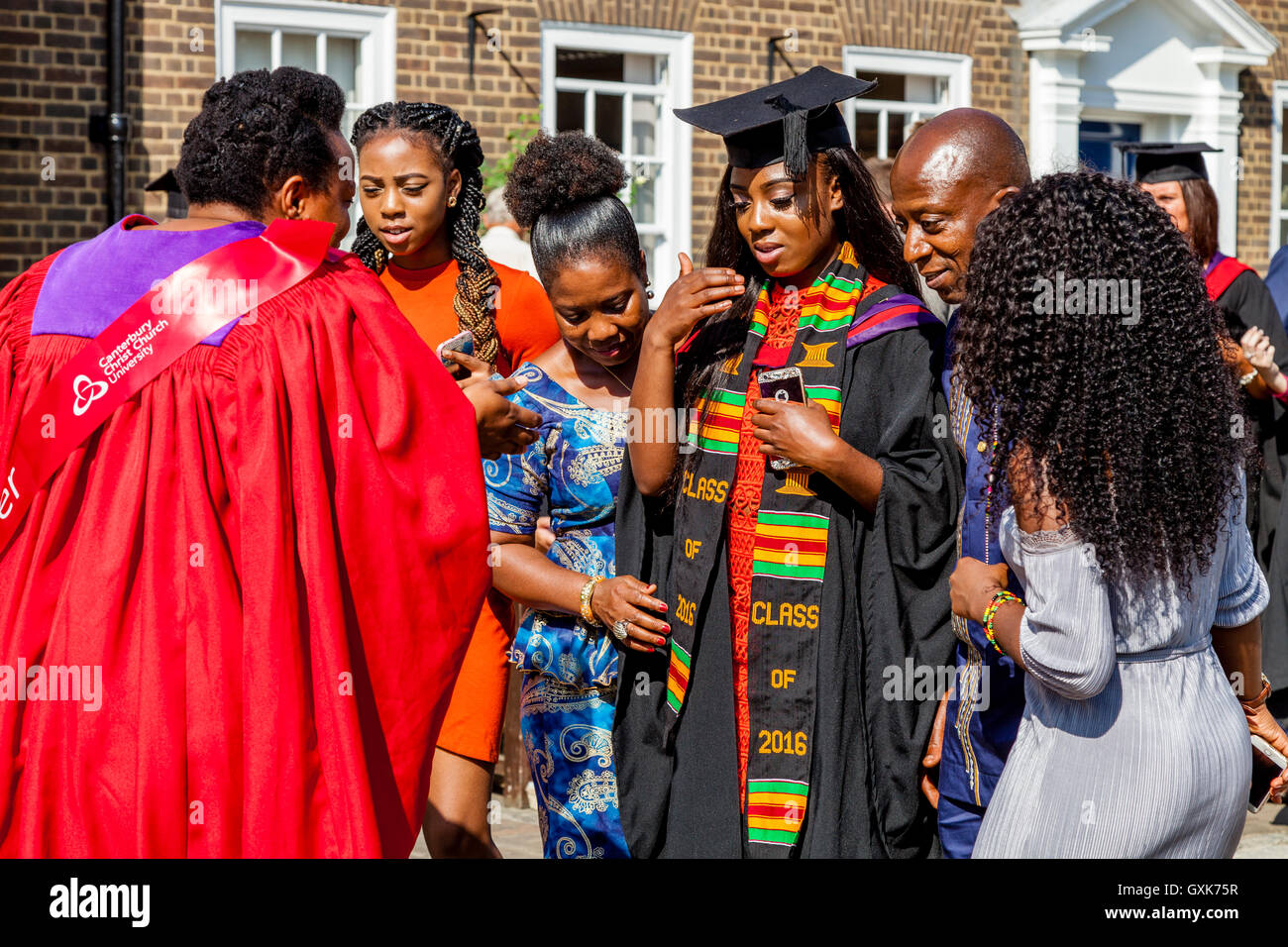 An Afro Caribbean Graduate and Her Family At Her Graduation Ceremony, Canterbury Cathedral, Canterbury, Kent, UK - Stock Image