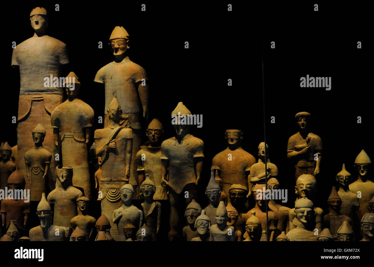 Sanctuary of Ayia Irini (1200-1st century BC). Cyprus. Statues and terracotta figurines found around the altar. - Stock Image