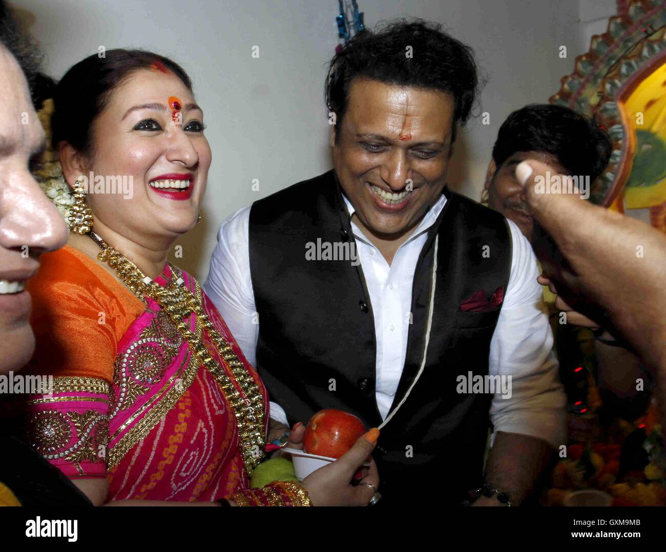 Bollywood actor Govinda along with his wife Sunita Ahuja ...