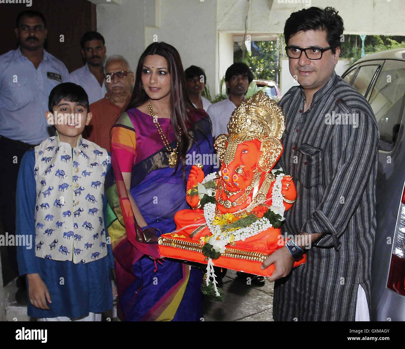 Bollywood actor Sonali Bendre Goldie Behl son participates procession immersion of an idol Hindu god Lord Ganesh - Stock Image