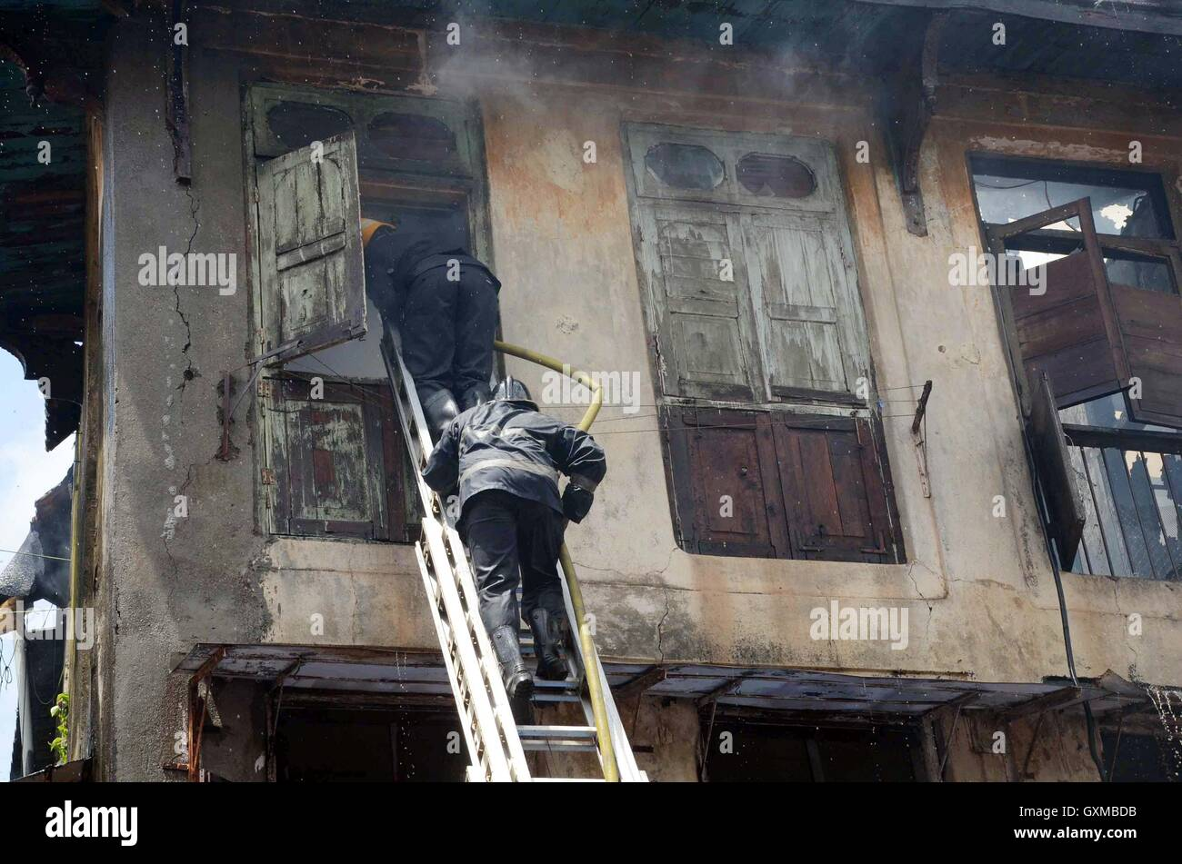 A fireman enters the second floor of the Bandookwala building at Matarpakadi Road, Mazgaon, which caught fire in - Stock Image