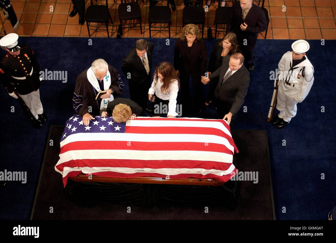 Former First Lady Nancy Reagan lays her head on the flag-draped casket of husband, former U.S. President Ronald - Stock Image
