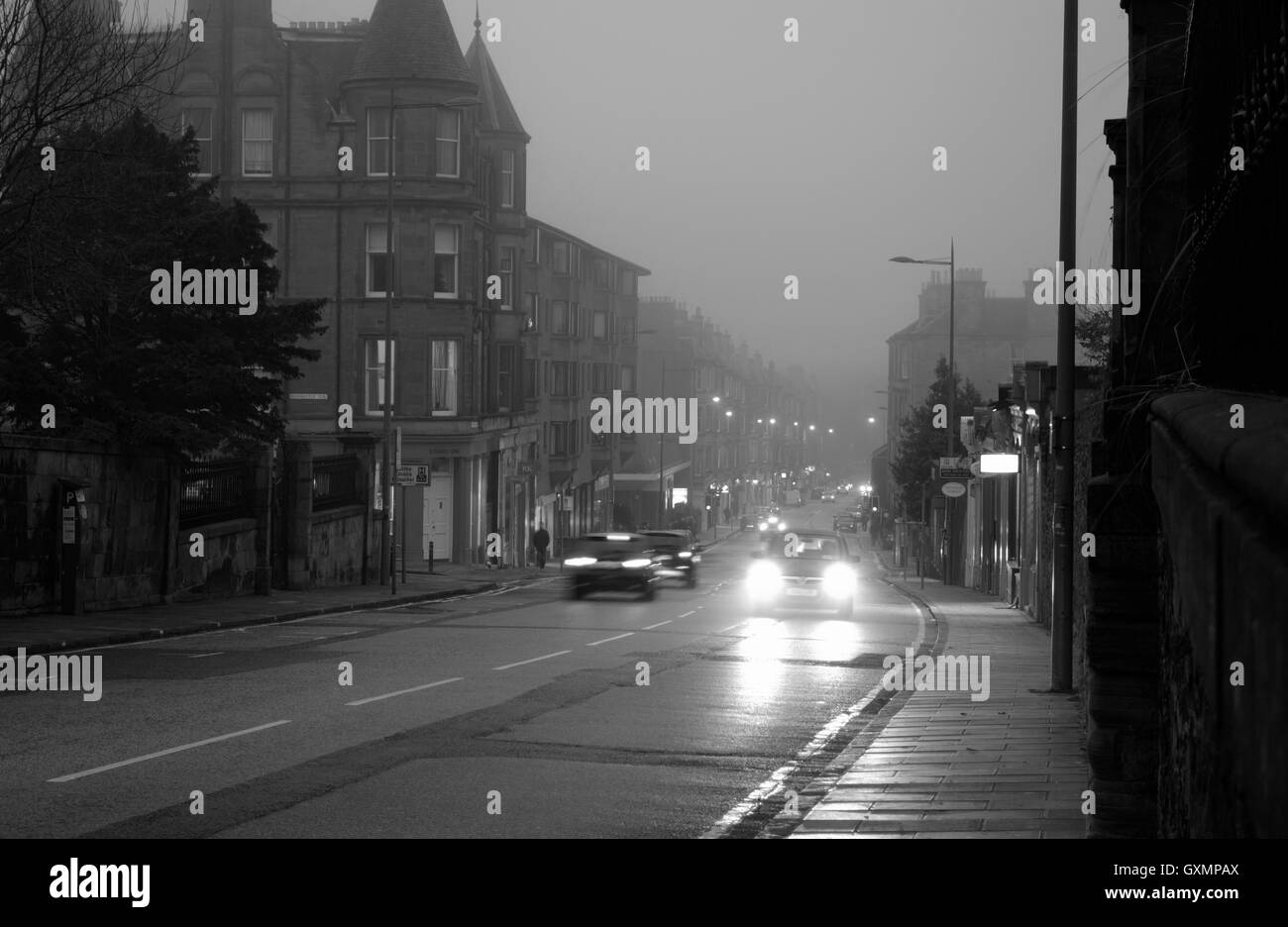 View down Morningside Road, Edinburgh on a misty winter's evening - Stock Image