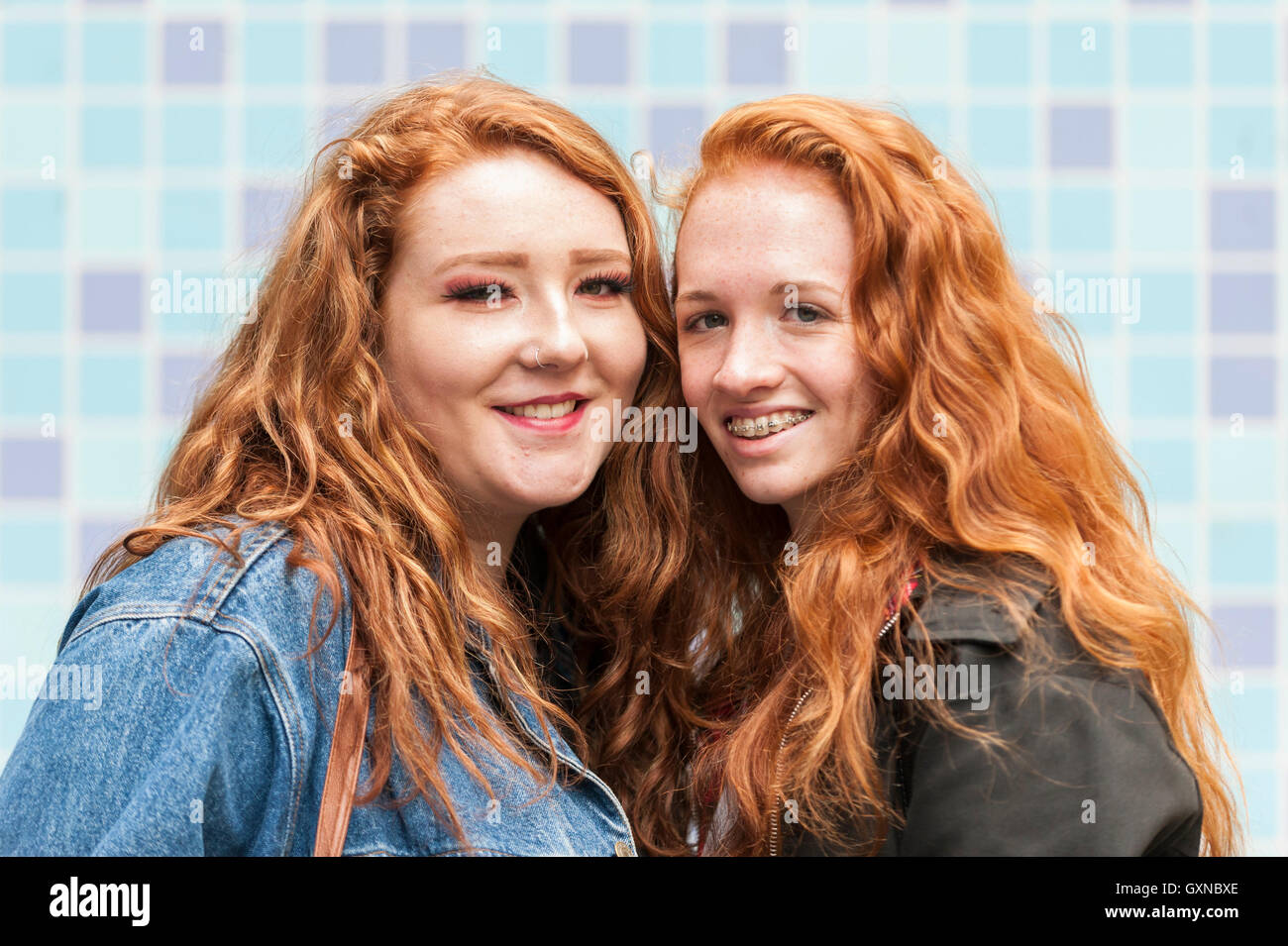 London, UK. 17th September, 2016.   Red-haired friends pose against a mosaic backdrop.  Ginger, auburn and redheaded - Stock Image