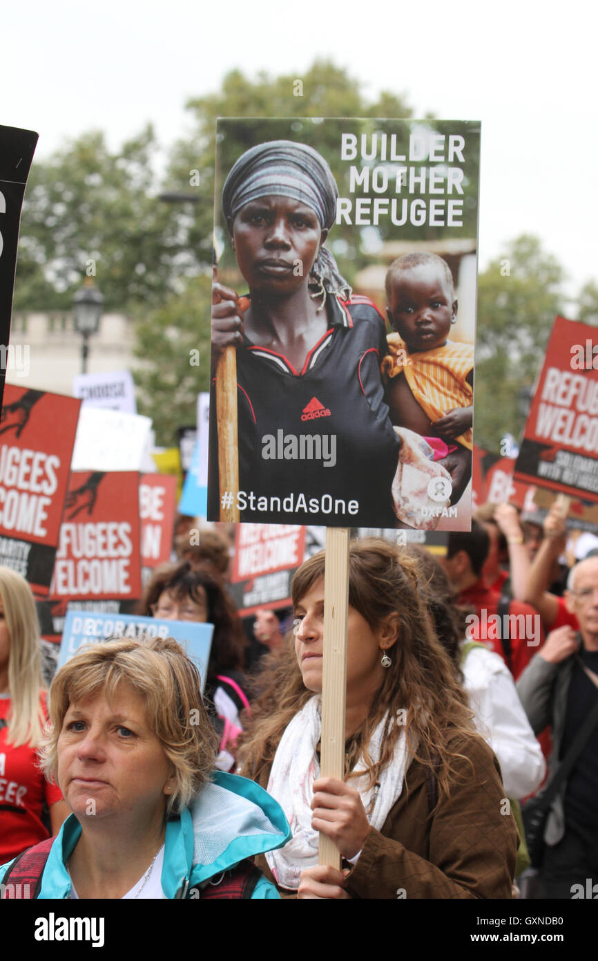 LONDON, UK - September 17: ​Thousands of people march through London to show solidarity with Refugees on 1​7​ September - Stock Image