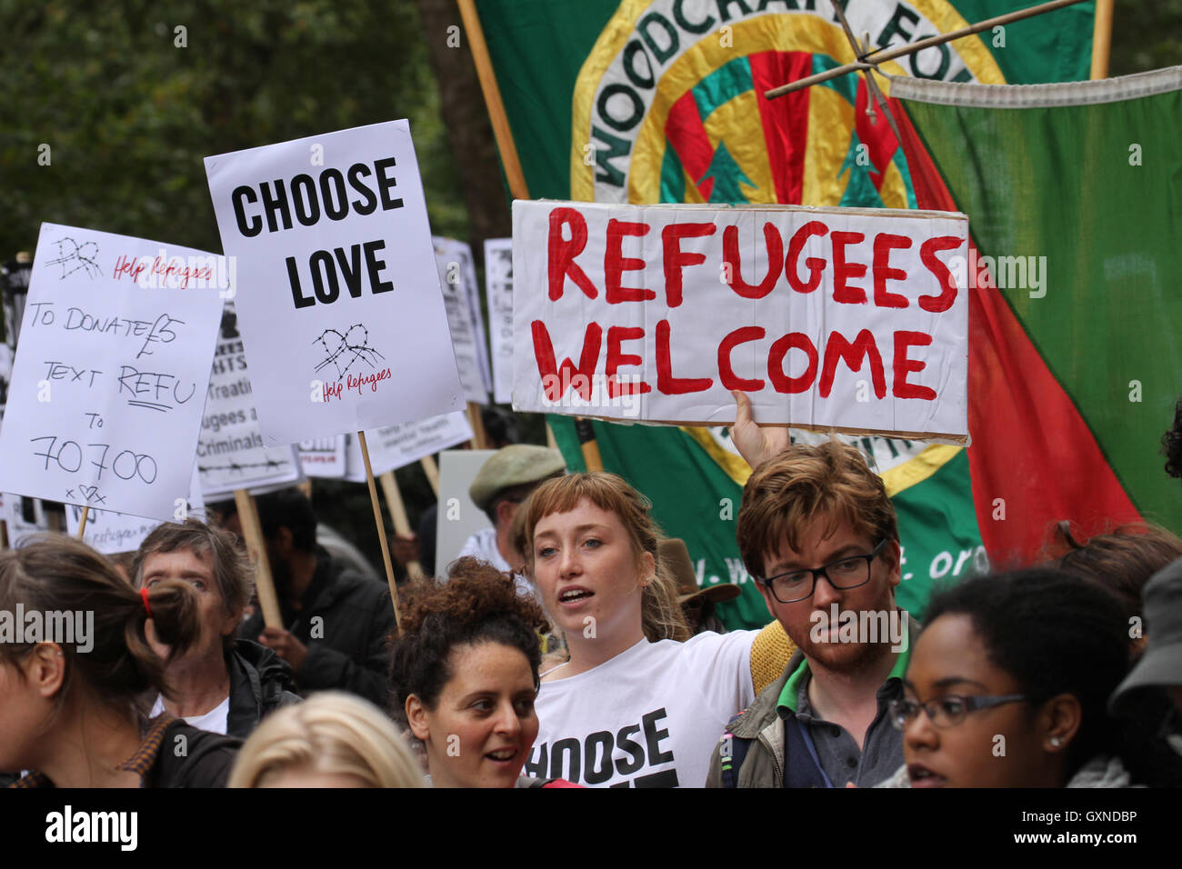 LONDON, UK - September 17: ​Thousands of people march through London to show solidarity with Refugees on 1​7 September - Stock Image