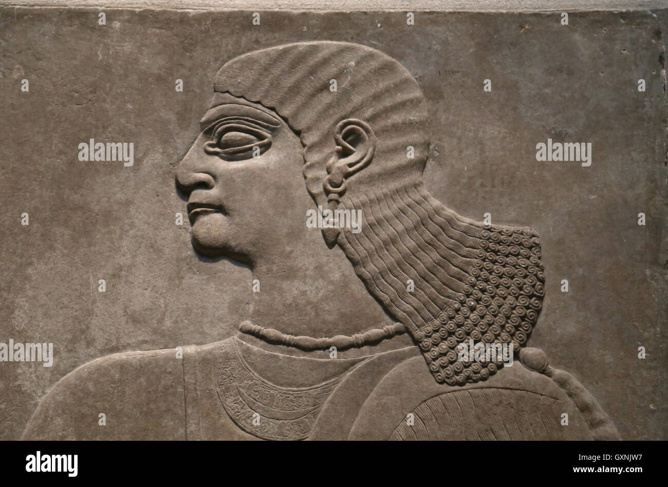 Relief of man.  9th century BC. Neo-Assyrian. Nimrud (ancient Kalhu). Northern Mesopotamia. Alabaster. - Stock Image