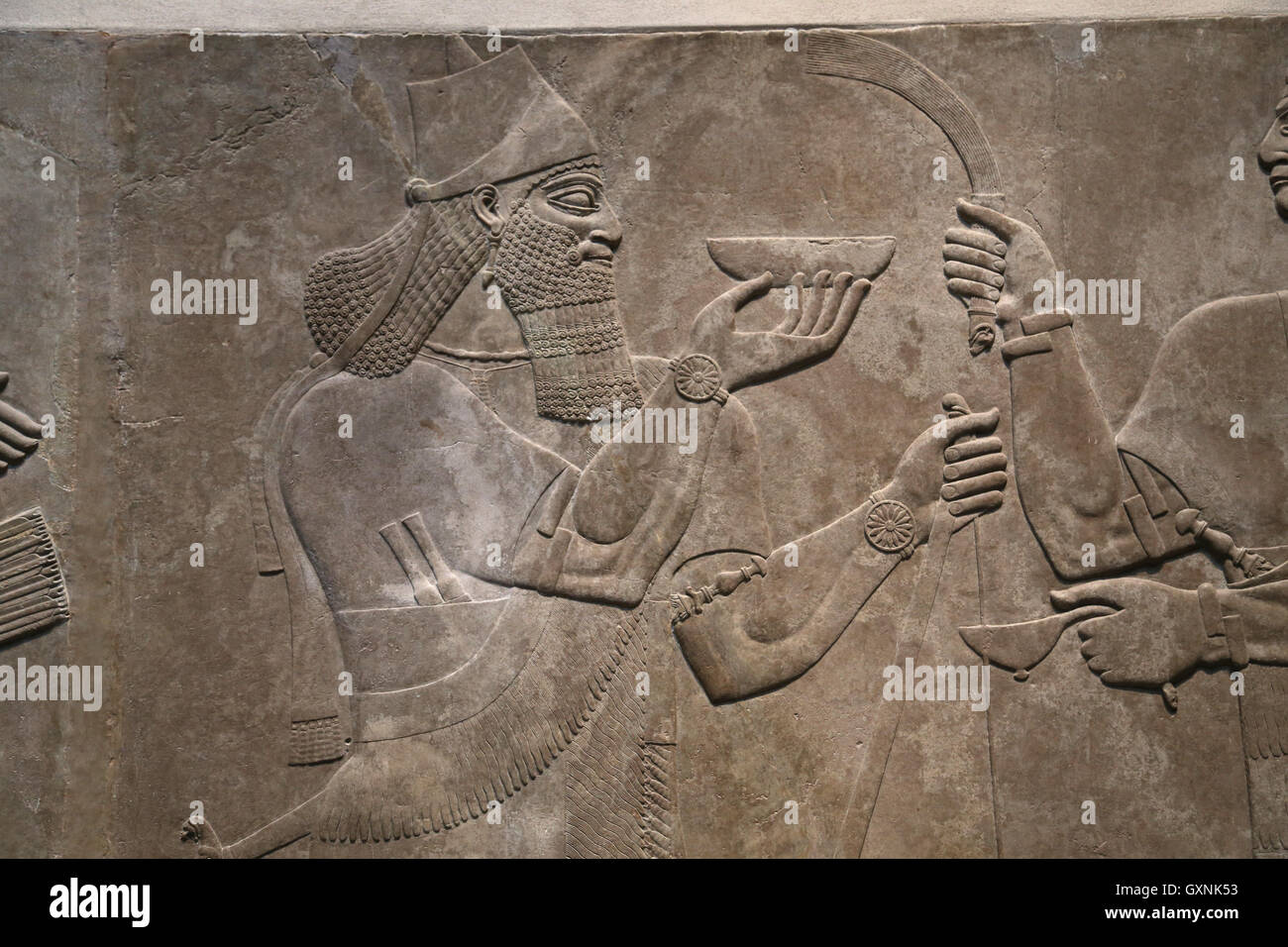 Relief King Ashurnasirpal II with ceremonial bowl. 883-859 B.C. Neo-Assyrian. Reign of Ashurnasirpal. Nimrud.  Mesopotamia. Stock Photo