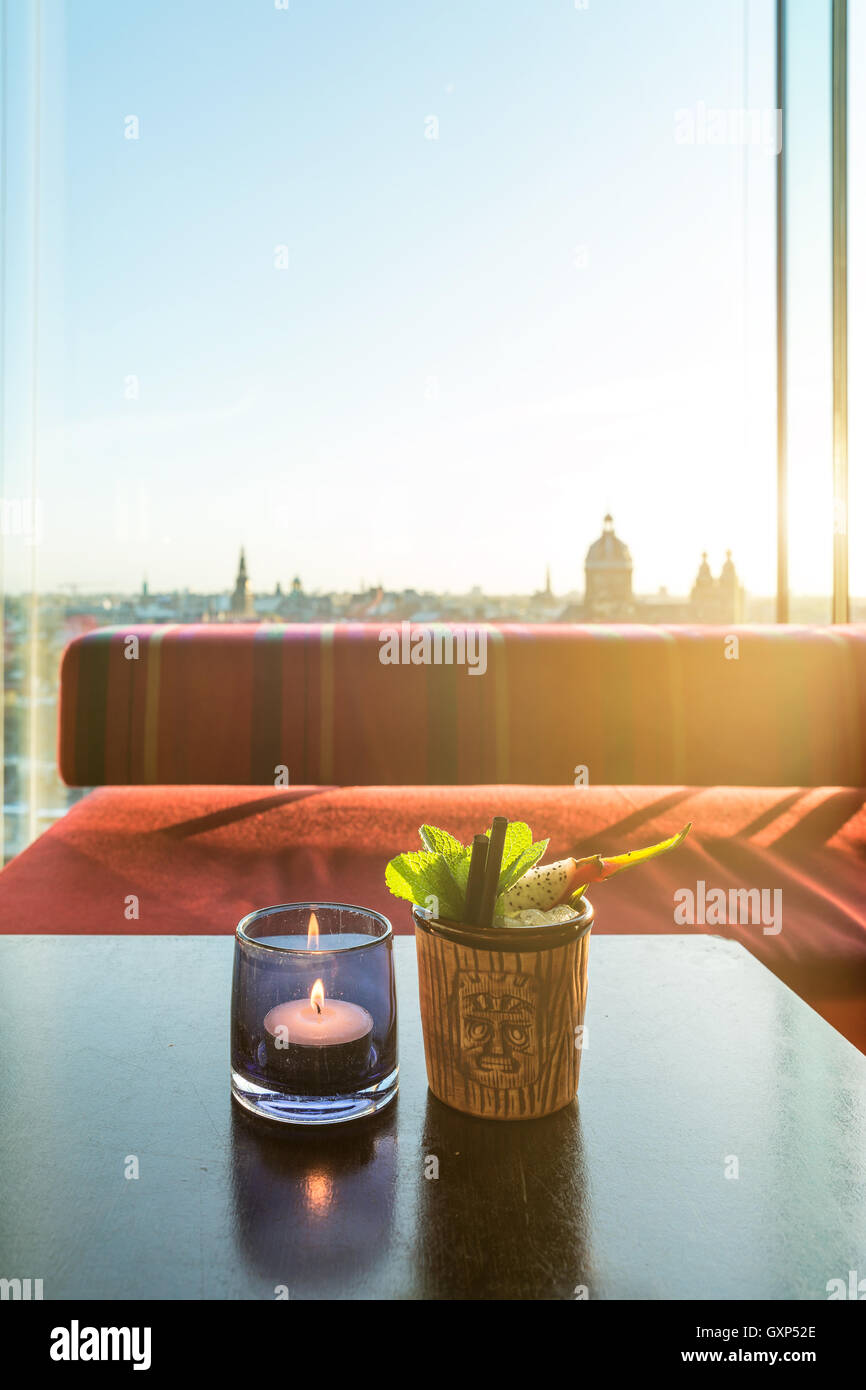 Tropical fruit dragon fruit cocktail on table in rooftop bar in Amsterdam, Netherlands. - Stock Image