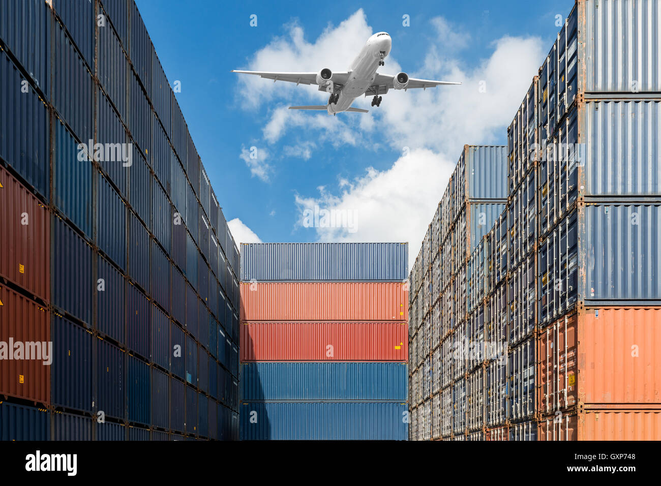 Stack of cargo containers with airplane at port terminal use for import, export and logistics background - Stock Image