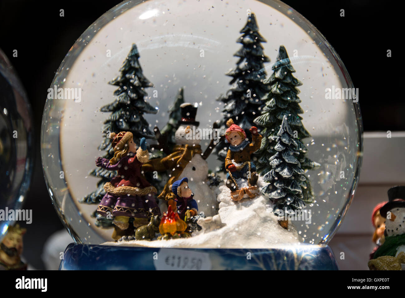 a large glass dome showing a christmas winter scenes on sale at the munich christmas market