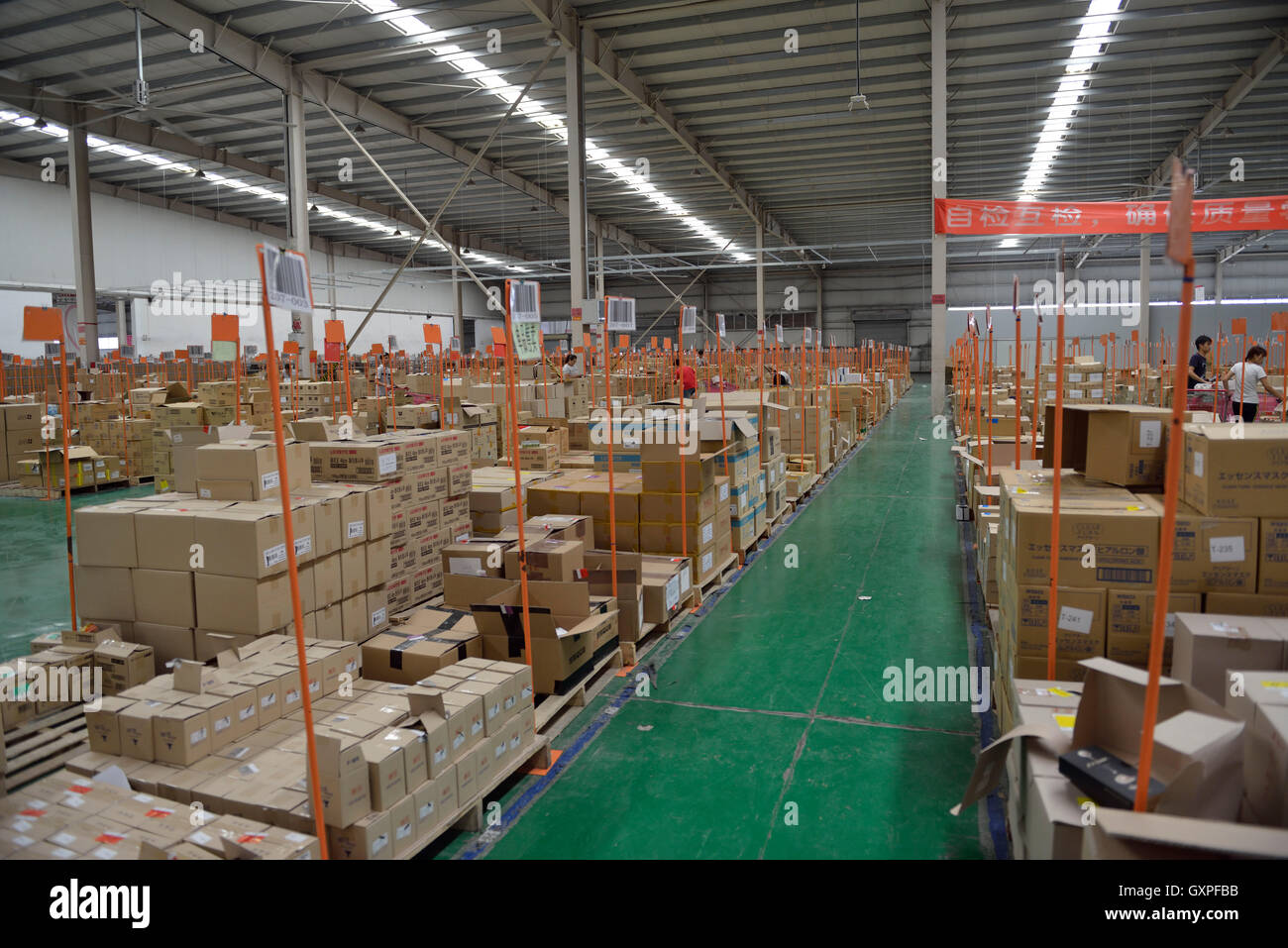 Storehouse for goods shopped from overseas through Jumei Global online channel during delivery at EHL International - Stock Image