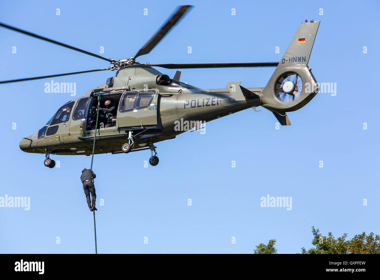 Exercise of a SWAT team, German police, anti Terror police unit, fast roping from a helicopter, - Stock Image