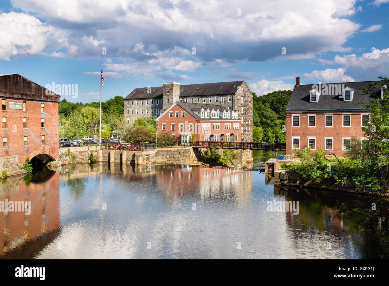 Old Textile Mills along the Lamprey River in New Market, New Hampshire - Stock Image