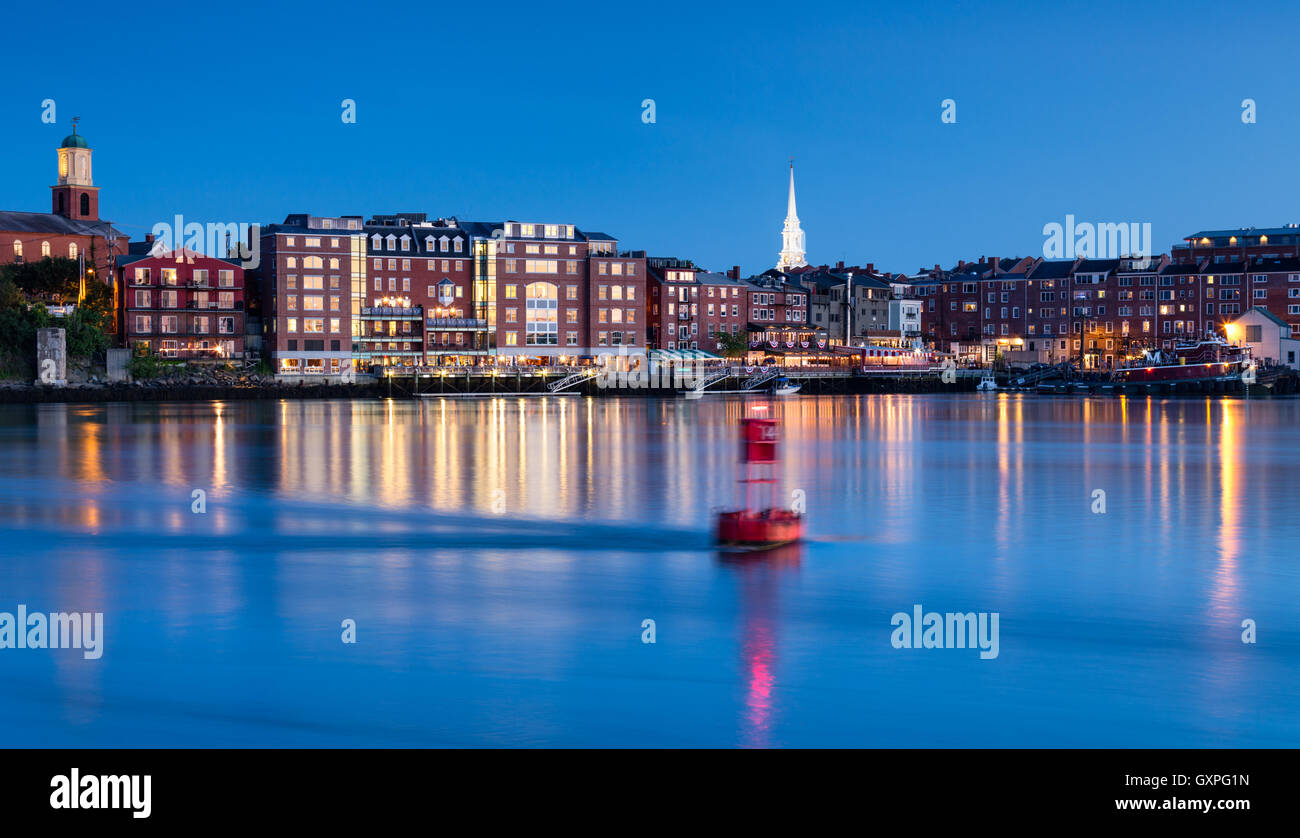 Blue Hour over Portsmouth, New Hampshire with the Piscataqua River swiftly flowing by. - Stock Image