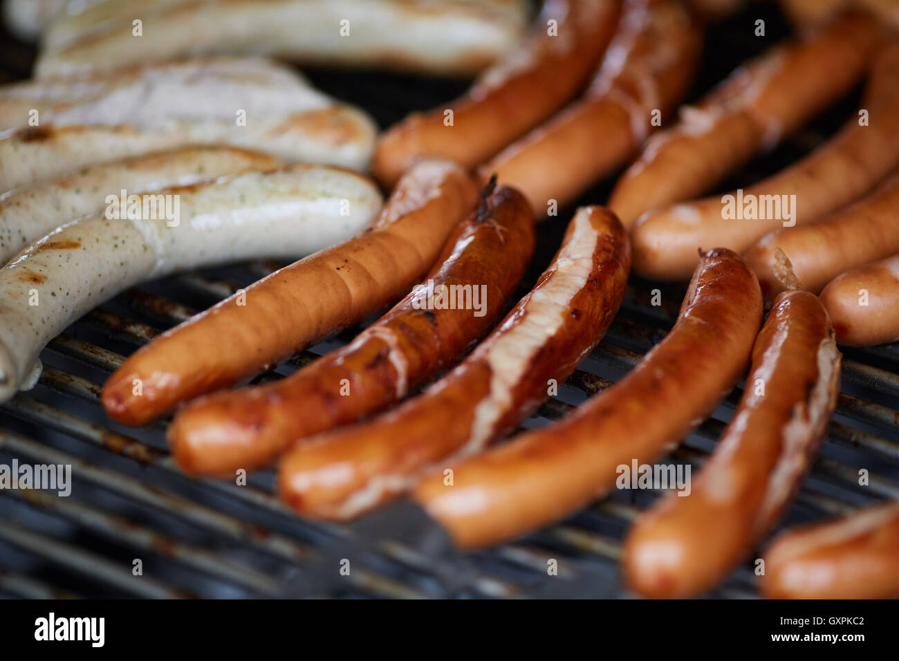 Bolton Food and Drink Festival  german germany sausage bbq tale away food cooking Frankfurter Rindswurst beef grilled - Stock Image