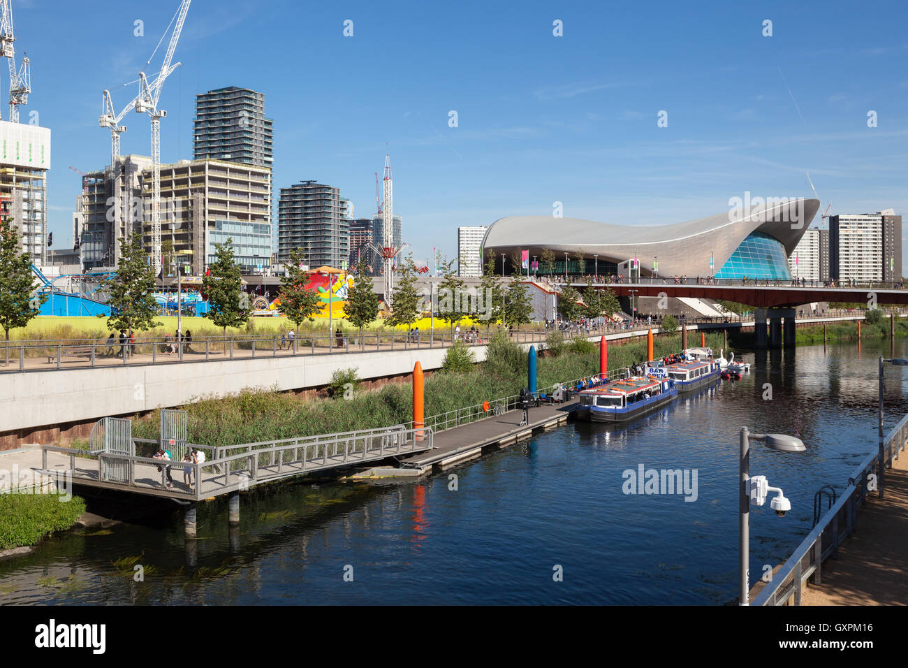 Building of the new International Quarter can be seen next to the London Aquatics Centre in East London. - Stock Image