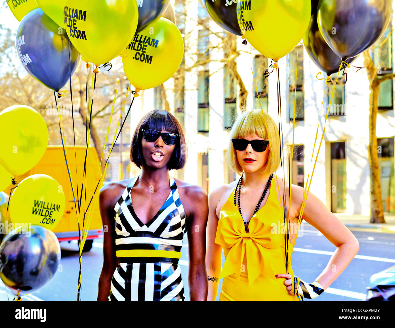 London Fashion Week Feb. 2013 Attractive Fashion Models with balloons promoting William Wilde exquisite handmade - Stock Image