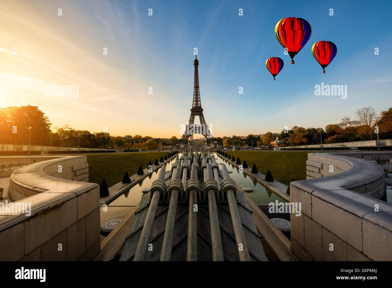 Hot air balloon with sunrise in Eiffel Tower in Paris, France ...