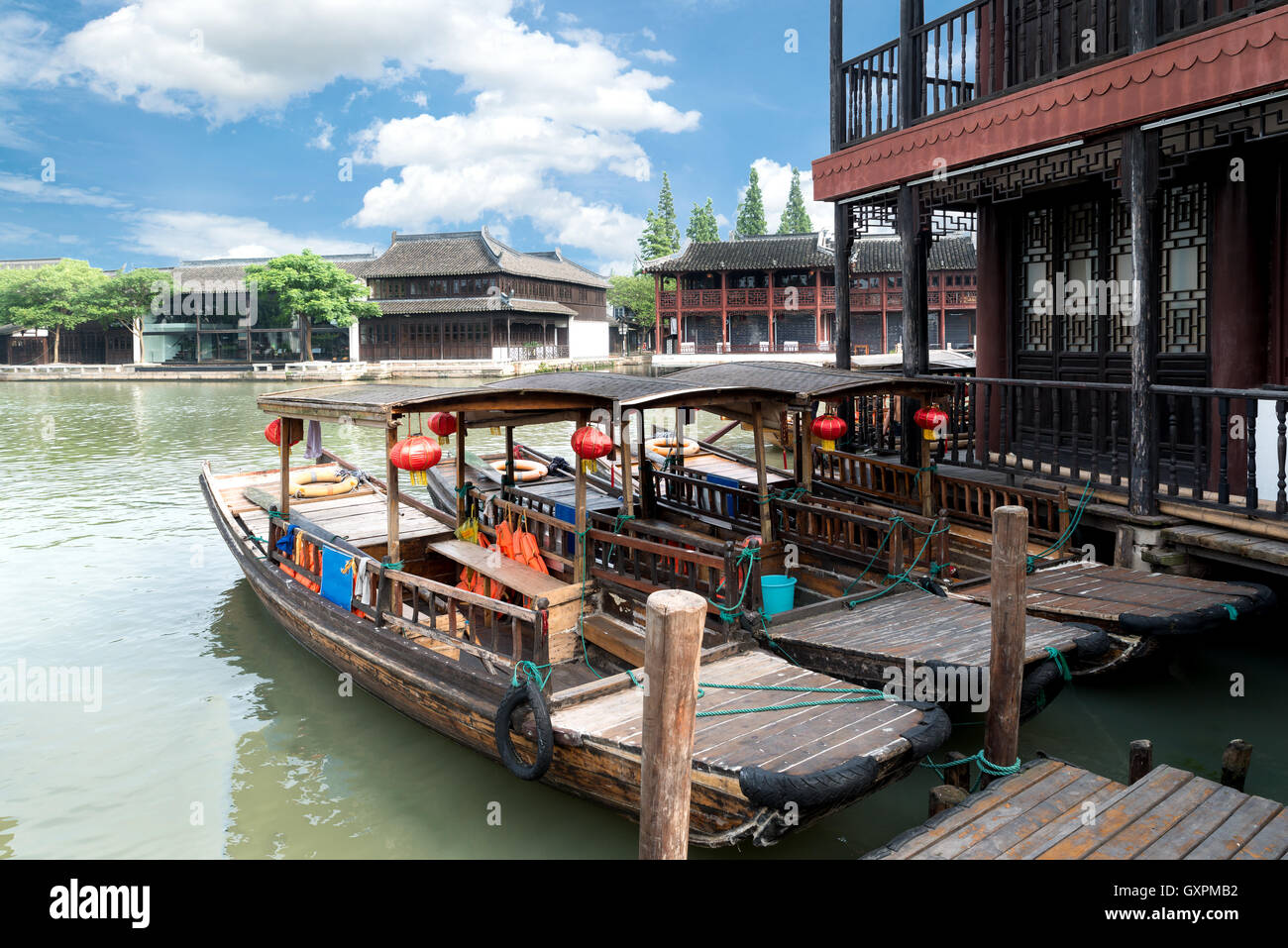 China traditional tourist boats on canals of Shanghai Zhujiajiao Water Town in Shanghai, China - Stock Image
