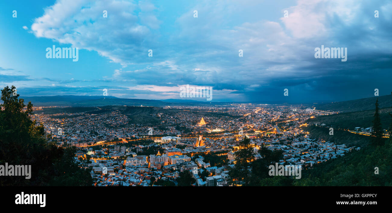 Panorama Of Tbilisi, Georgia. Aerial Cityscape View Of Capital In Evening Illimination, Modern Uptown, Baratashvili - Stock Image