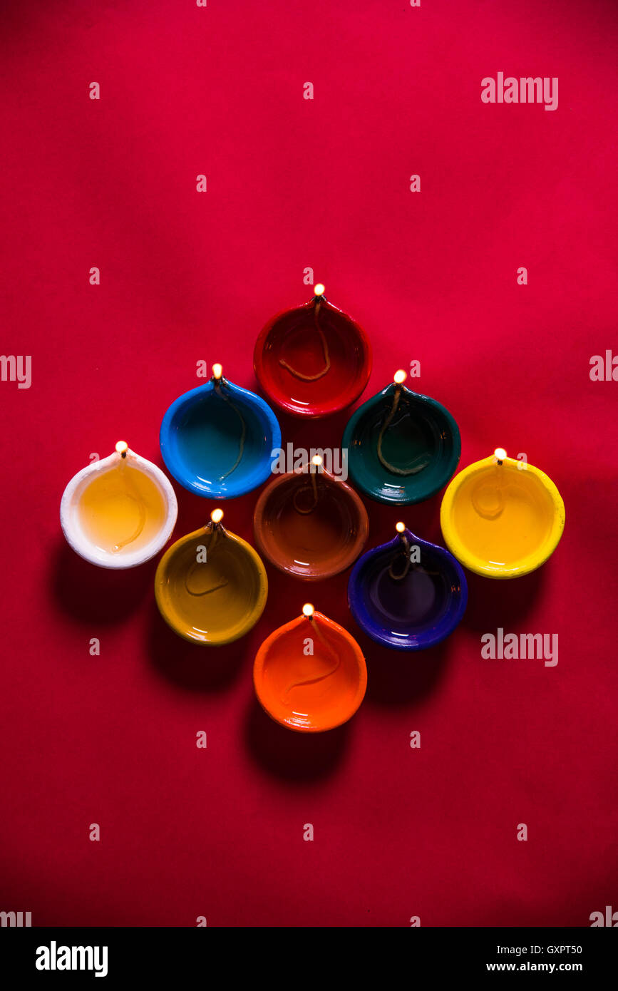 Colourful Diwali Diya On Colourful Background Suitable For Diwali