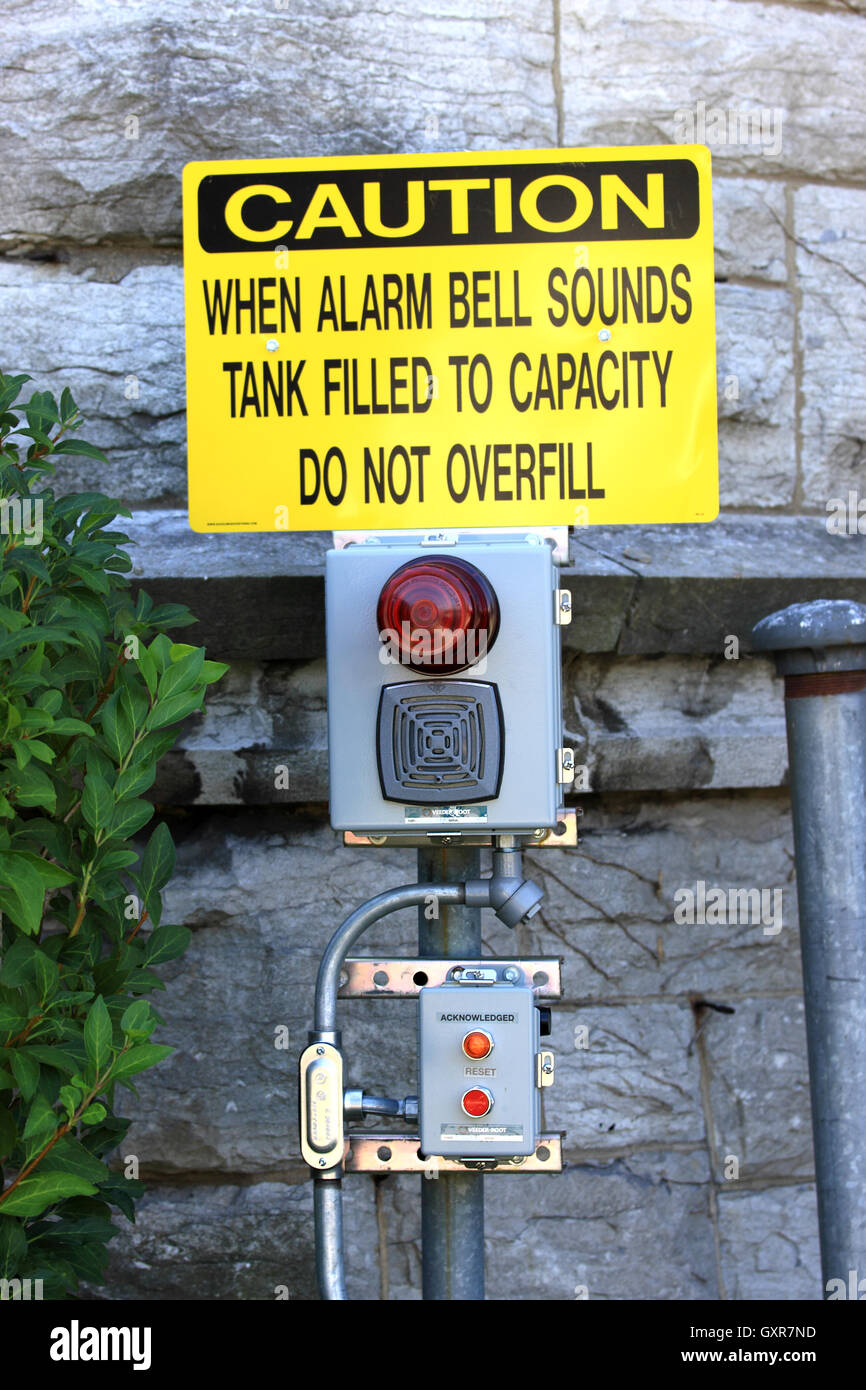 Oil tank overfill alarm system - Stock Image