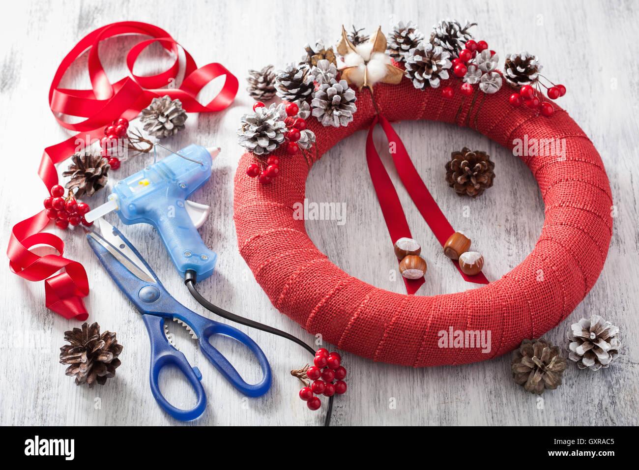 making red christmas wreath diy handmade - Stock Image