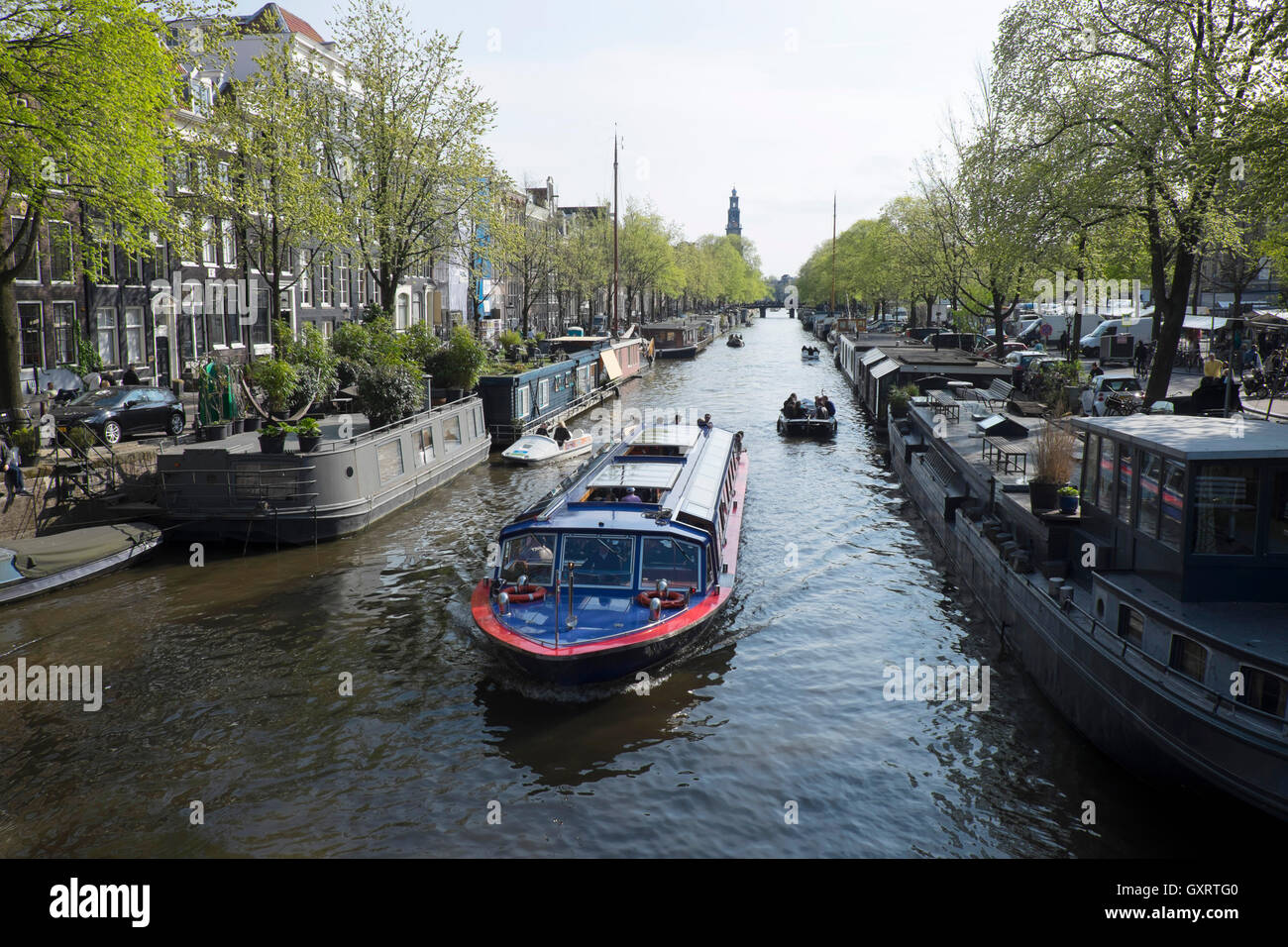 Canal with tourist boats  in Spring, Amsterdam, Holland, Stock Photo